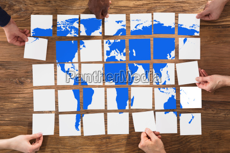 group of people arranging the world