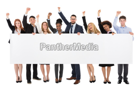businesspeople holding long blank banner
