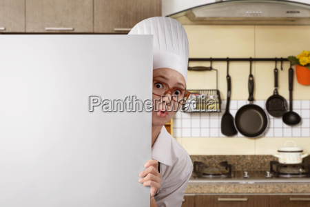 young asian woman chef standing from