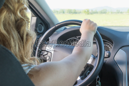 young driver woman is driving a
