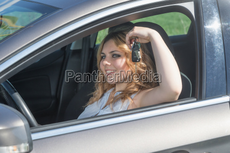 smiling young driver woman is sitting