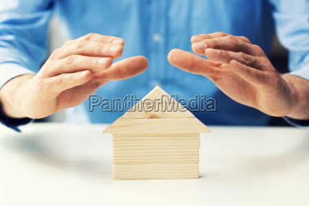property insurance concept man protect model