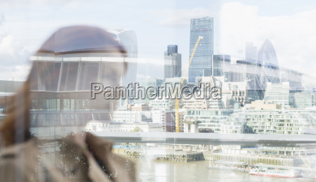 businesswoman on urban balcony with city