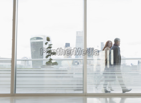 businessman and businesswoman walking on urban