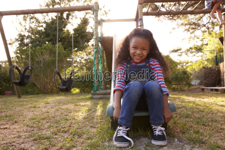portrait of girl playing outdoors at