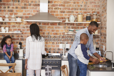 children helping parents to prepare meal