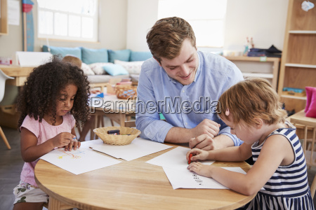 teacher and pupils practicing writing in