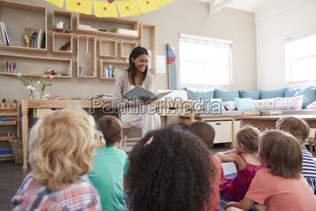 teacher at montessori school reading to