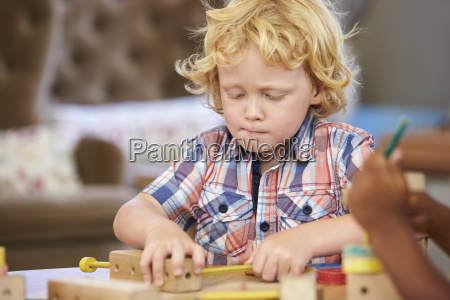 montessori pupil working at desk with