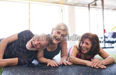 senior friends having fun in gym