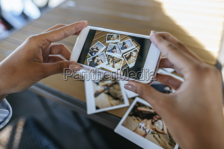 womans hands taking picture of instant