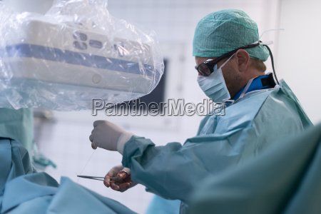 interventional radiologist setting seam for fixing