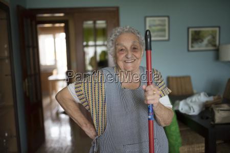 portrait of smiling senior woman holding