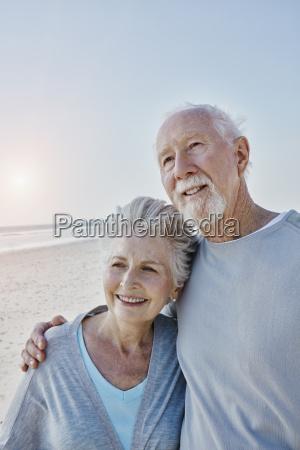 smiling senior couple on the beach