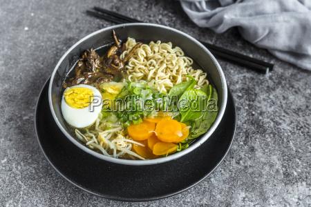 bowl of ramen soup with spinach