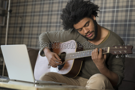man sitting in living room on