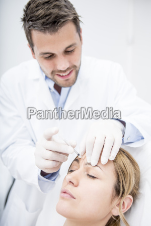 aesthetic surgery woman receiving injection into