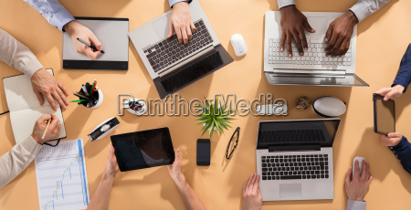 businesspeople hands on office desk