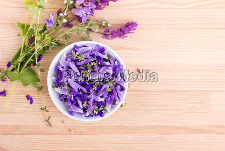 bowl of edible flowers and herb