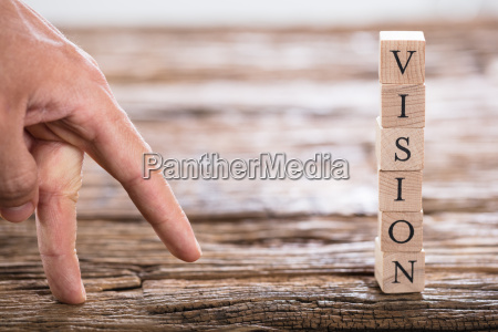 persons finger and vision word on
