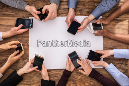 elevated view of businesspeople hand using