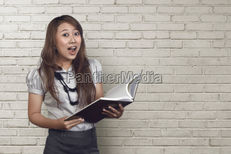young asian business woman making funny