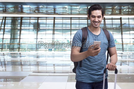 handsome asian man traveler with suitcase