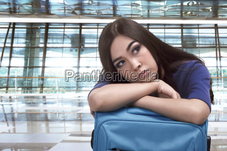 elegant asian woman traveler embrace blue