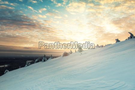 beautiful winter sunset landscape in luosto