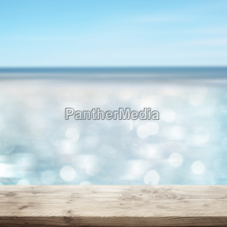 glittering sea with wooden table