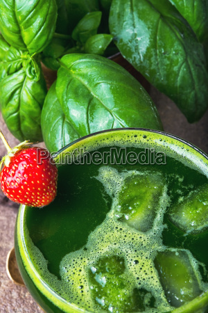 cocktail with basil leaves and strawberry