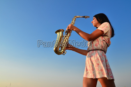 a young girl with a saxophone