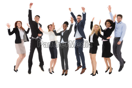 excited businesspeople raising their hands