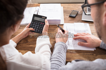 couple calculating home bills