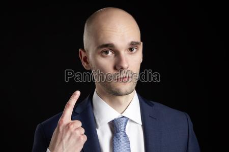 man threatens finger