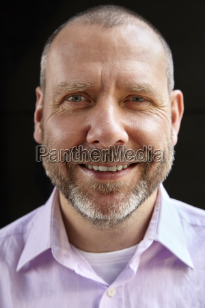close up portrait of cheerful man
