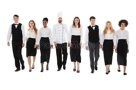 restaurant staff walking against white background