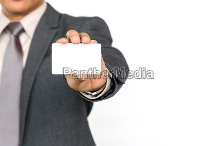 a businessman holding a white blank