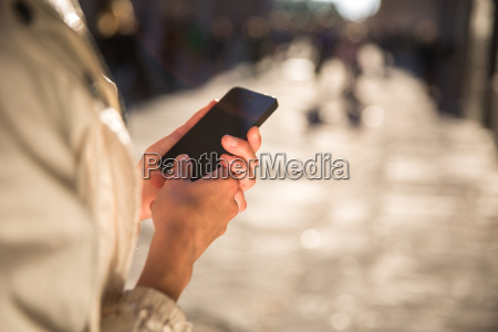 young woman messagingusing an app on