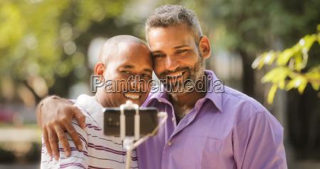 homosexual gay couple men taking selfie