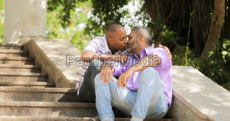 gay people two men kissing on