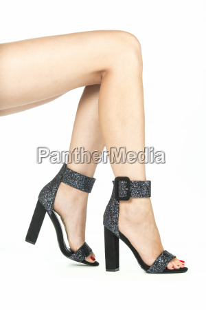 legs with high heels in sparkling