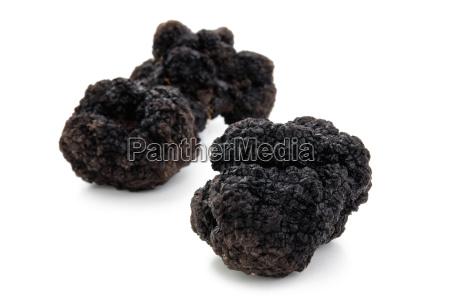 black truffles on white
