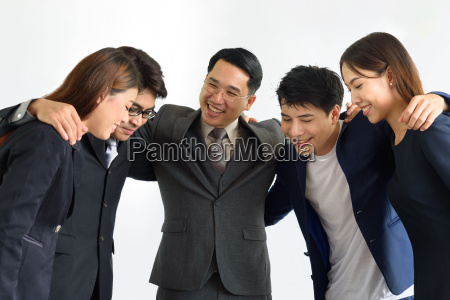 group of successful business people hugging