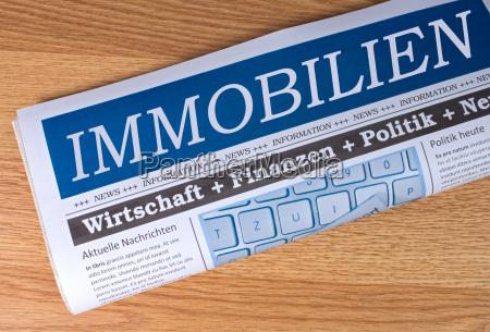 real estate newspaper on wood desk