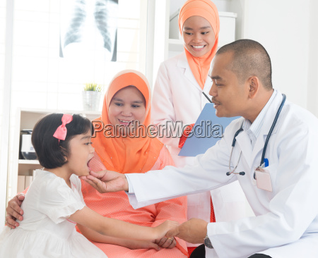 southeast asian medical doctor and patient