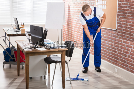 male janitor mopping floor