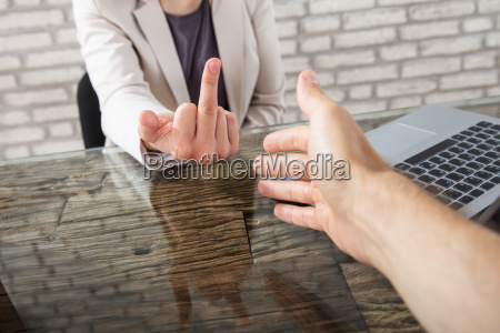 businesswoman showing fuck sign to a