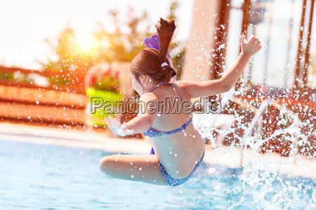active little girl in the pool