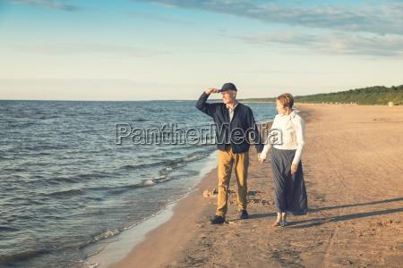 elderly couple having romantic walk on